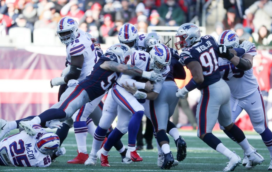 Bills quarterback Josh Allen rushes for a first down past New England Patriots outside linebacker John Simon in the second quarter. (James P. McCoy/Buffalo News)