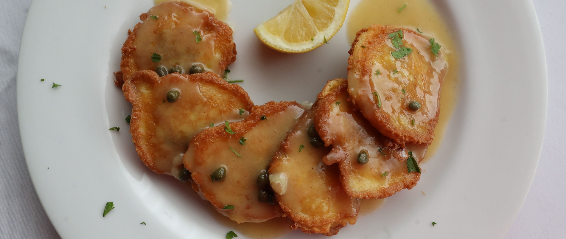 Of the Artichoke Francese at Sinatra's, News Food Editor Andrew Z. Galarneau writes, 'Artichoke hearts in puffy Romano-stuffed jackets, napped with velvety butter-lemon sauce perked up with capers, were pitch perfect.' (Sharon Cantillon/Buffalo News)