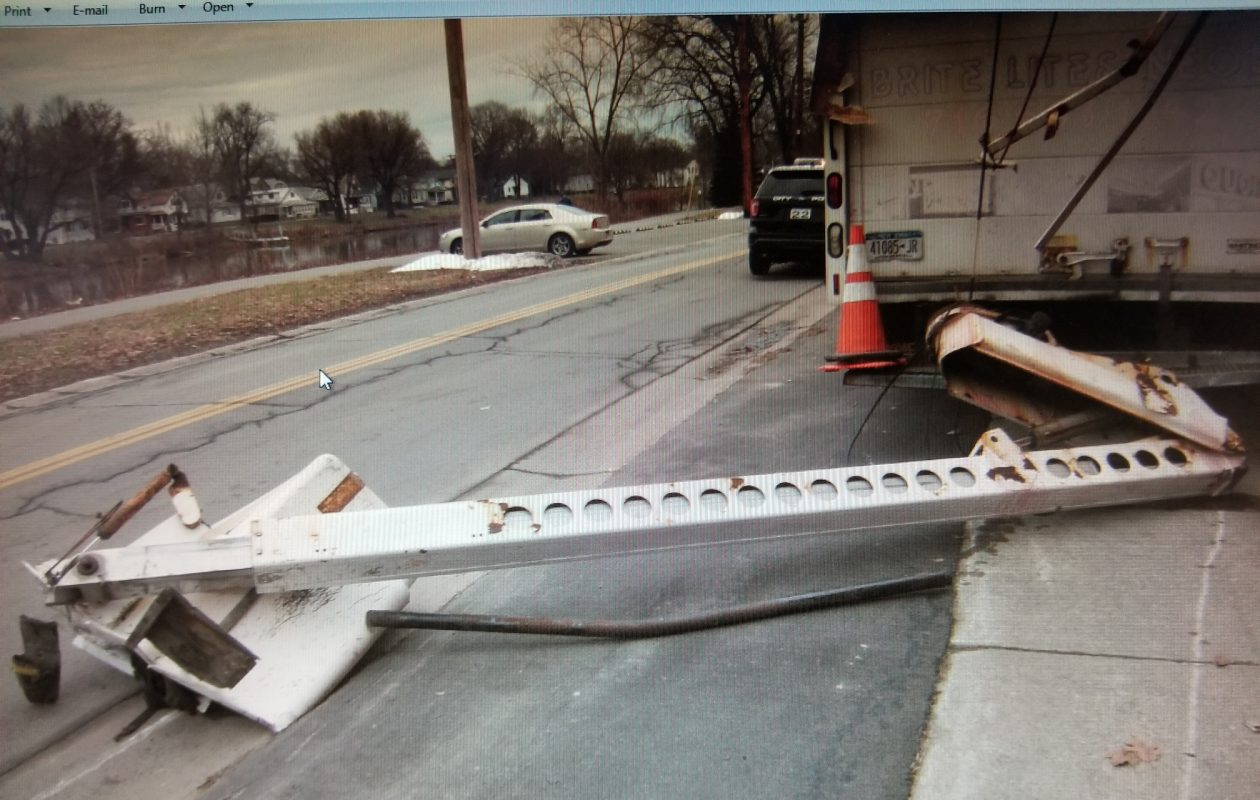The arm of a bucket truck lies on the ground after the truck hit a railroad overpass in the City of Tonawanda. (Photo courtesy of the City of Tonawanda Police Department)