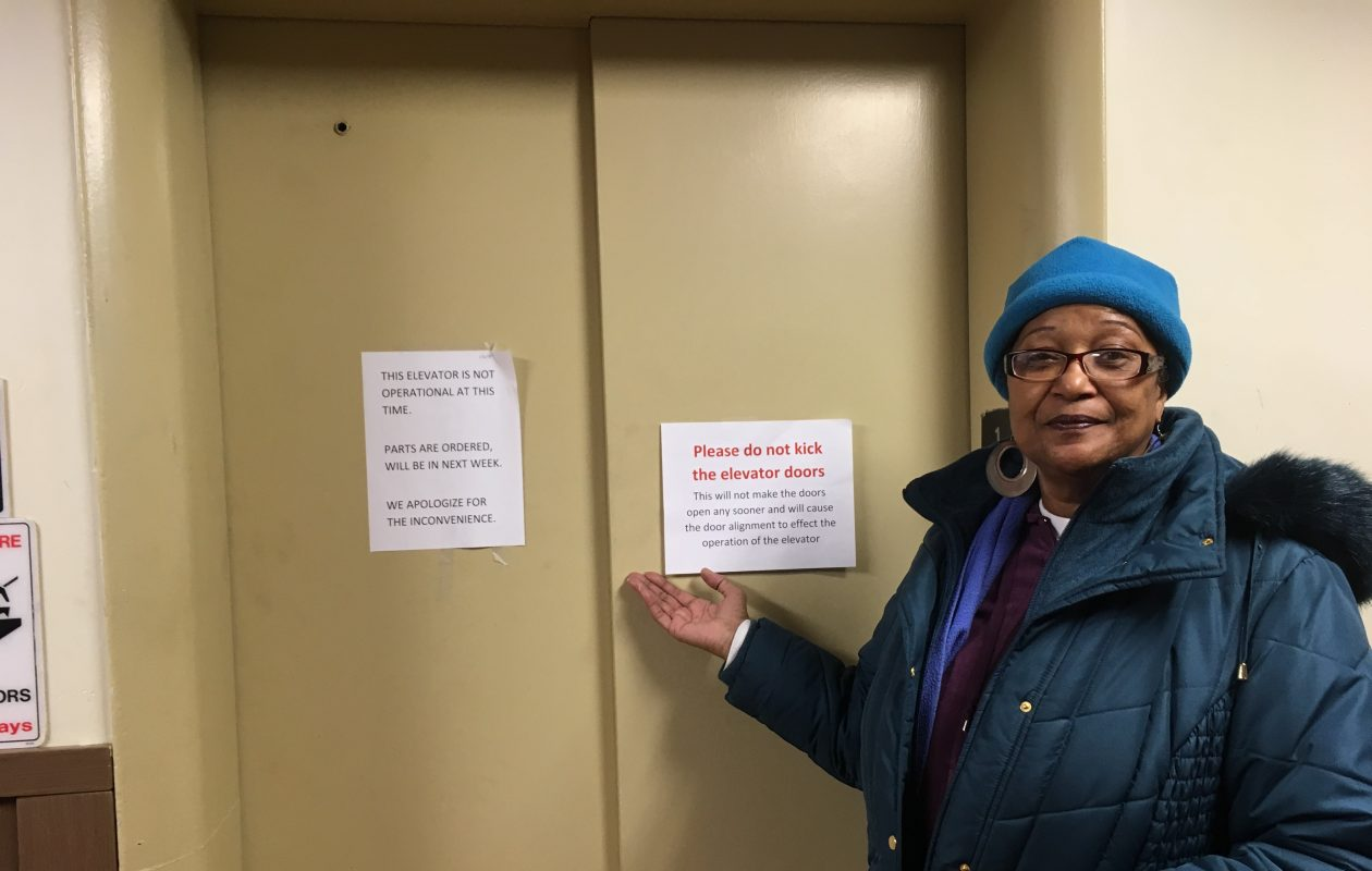 L.B. Johnson Apartments  tenant representative Carmela Dorsey in front of a broken elevator at the 10-story complex owned by the Buffalo Municipal Housing Authority. (Susan  Schulman/Buffalo News)