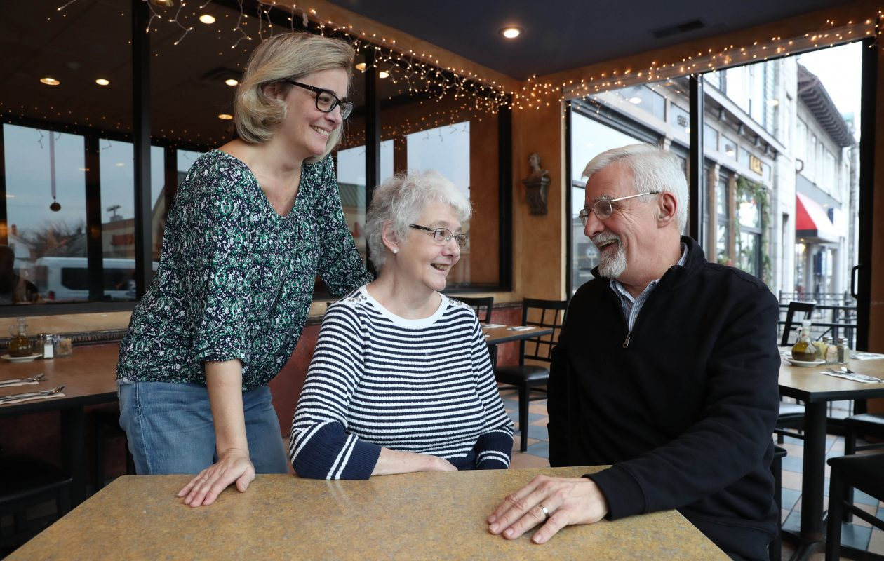 AncestryDNA brought together first cousins and an aunt separated by a death in a plane crash in 1941. From left are Kristen Sikorski and her mother Janet Kuebler, of Kenmore and their long-separated first cousin and nephew James Barnett Jr. (Sharon Cantillon/Buffalo News)