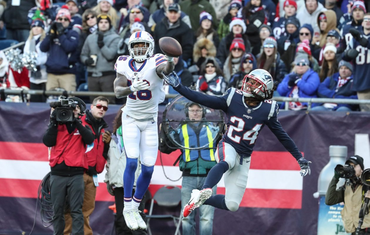 Bills wide receiver Robert Foster drops a pass while covered by New England Patriots cornerback Stephon Gilmore. (James P. McCoy/Buffalo News)