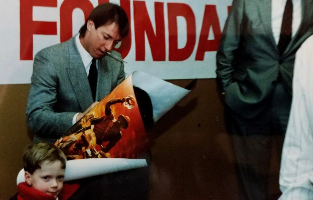 In 1989, 5-year-old Kevin Kita – not long past open heart surgery – waits for Bills quarterback Jim Kelly to sign a poster. (Family photo)