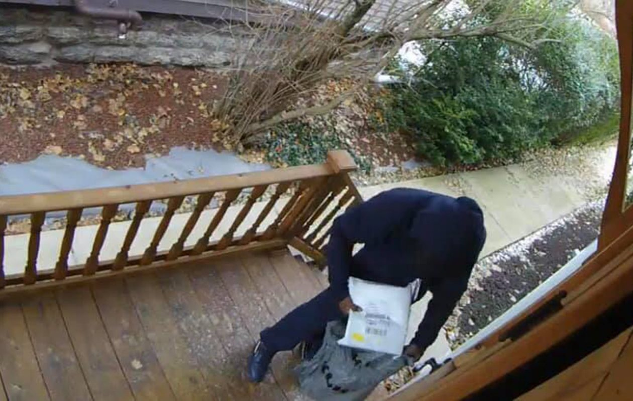 A home surveillance camera caught a porch pirate in action at a home in Buffalo. Buffalo police posted this image on their Facebook page last week to warn residents to keep track of their packages. (Courtesy of the Buffalo Police Department)