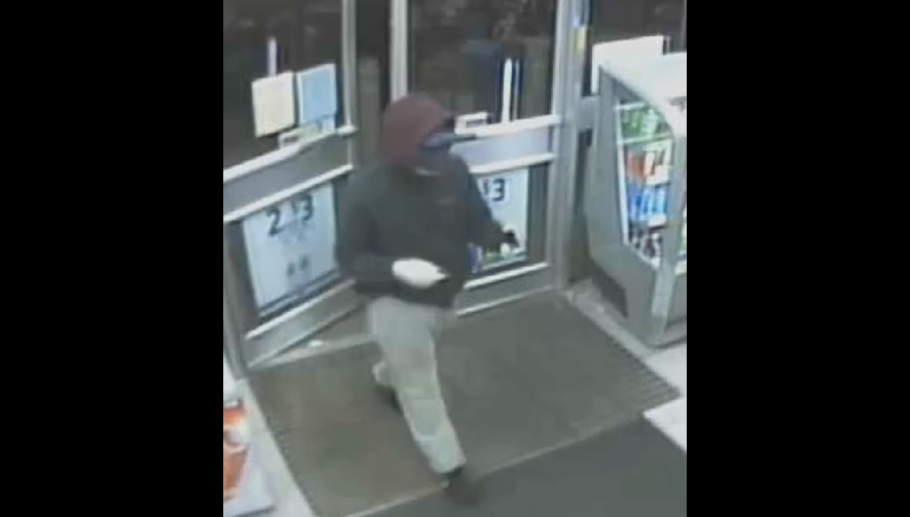 Surveillance footage shows the suspect who robbed the Sunoco gas station at 6730 Packard Road on Sunday morning. (Niagara County Sheriff's Office)