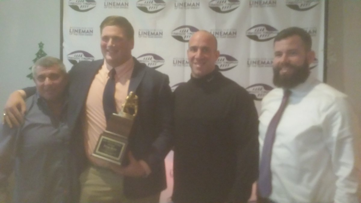 St. Joe's senior Tyler Doty, second from the left, is happy as can be after being selected as the winner of the Trench Trophy.