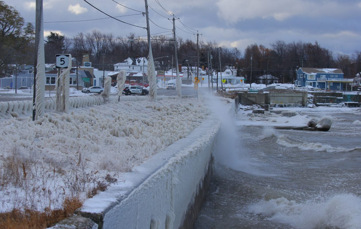 Waves break over the retaining wall at Route 5 in Hamburg in 2016, forcing the roadway to be shut down. (John Hickey/News file photo)