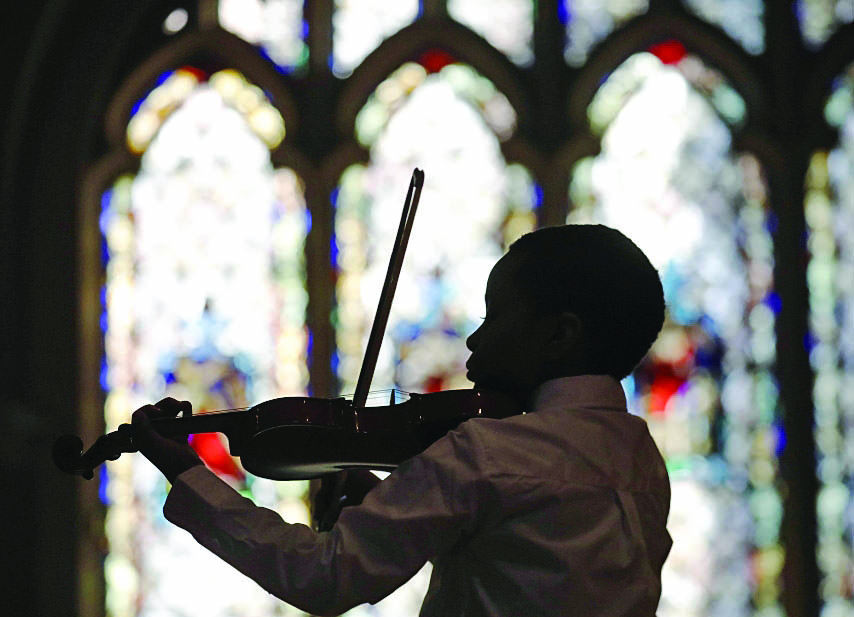 A student performs at the Aloma D. Johnson Charter School on Sunday, Feb. 18, 2018. (Derek Gee/Buffalo News)