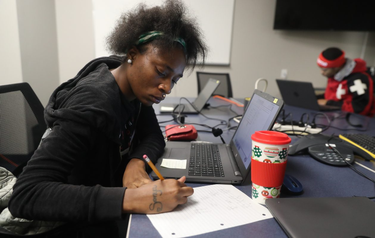 Brierra Inman, 18, takes a test at Catholic Charities Workforce and Education Services. (John Hickey/Buffalo News)