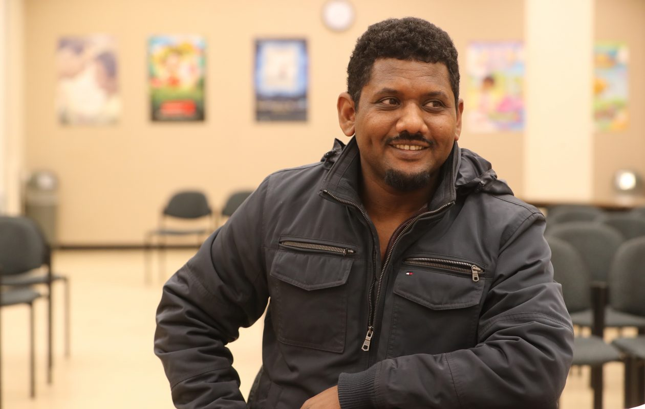 Mohamed Abdulla, 35, a refugee from Eritrea, lives in Buffalo, works at Burger King and is now a  student, being tutored through Literacy New York, at Buffalo and Erie County Public Library. (John Hickey/Buffalo News)