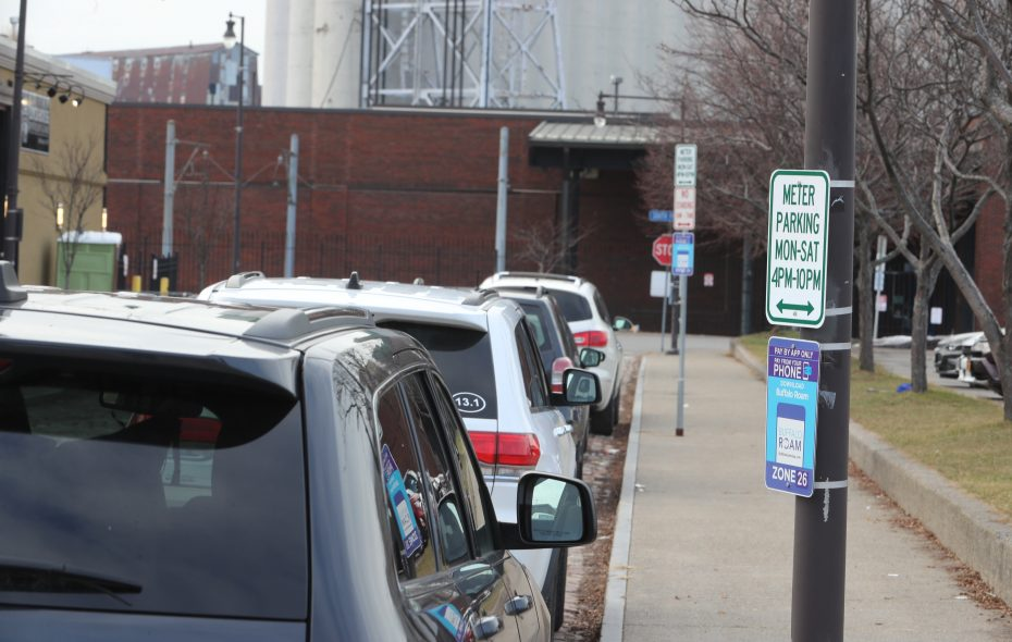 Workers installed new parking sign rules including $2 an hour parking around Cobblestone District on Columbia Street, and extended metered parking  in Buffalo, N.Y., on Wednesday, Jan. 2, 2019.  (John Hickey/Buffalo News)
