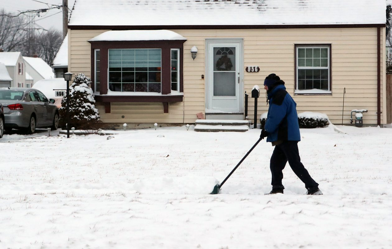 Fritz Stack shovels his driveway and sidewalk  Cleveland Drive, in Cheektowaga on Thursday, Jan. 10, 2019. (John Hickey/Buffalo News)