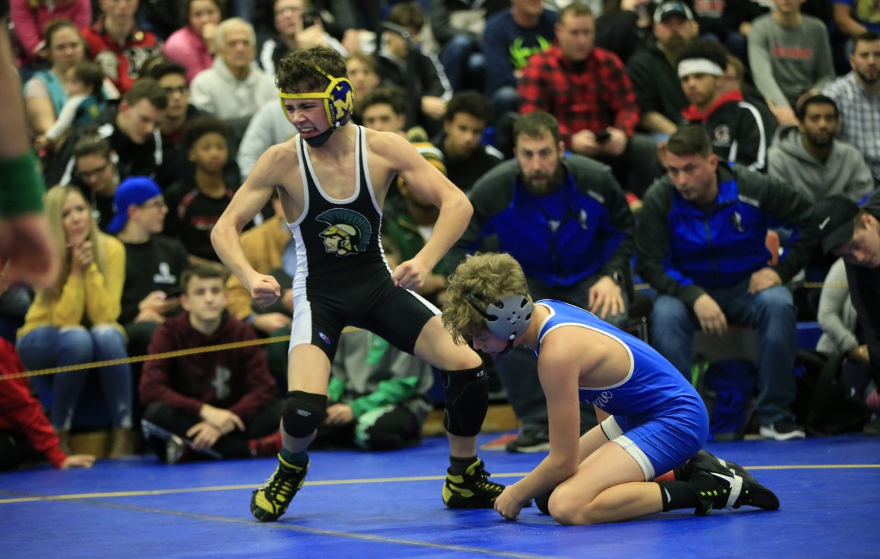 Williamsville North's Cameron Catrabone celebrates after defeating Newfane's Andy Lucinski in the 99-pound championship match during the NFWOA Tournament at Niagara Community College on Saturday. (Harry Scull Jr./ Buffalo News)