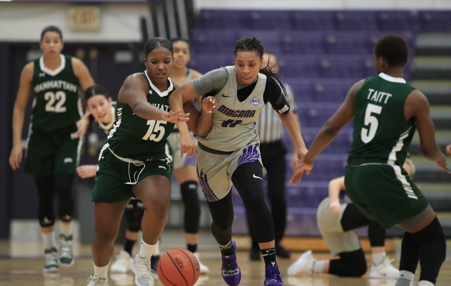 Niagara University's Kharysma Bryant and Manhattan's Sydney Watkins battle for a loose ball during first half action at the Gallagher Center on Saturday, Jan. 5, 2019. (Harry Scull Jr./ Buffalo News)