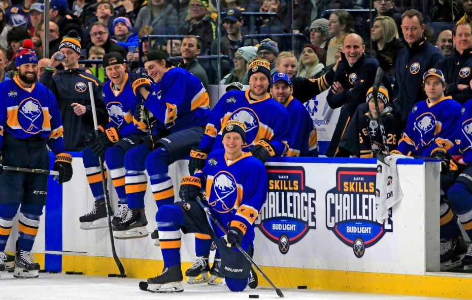 Buffalo Sabres players watch as teammates compete in the skills competition Sunday in KeyBank Center. (Harry Scull Jr./Buffalo News)