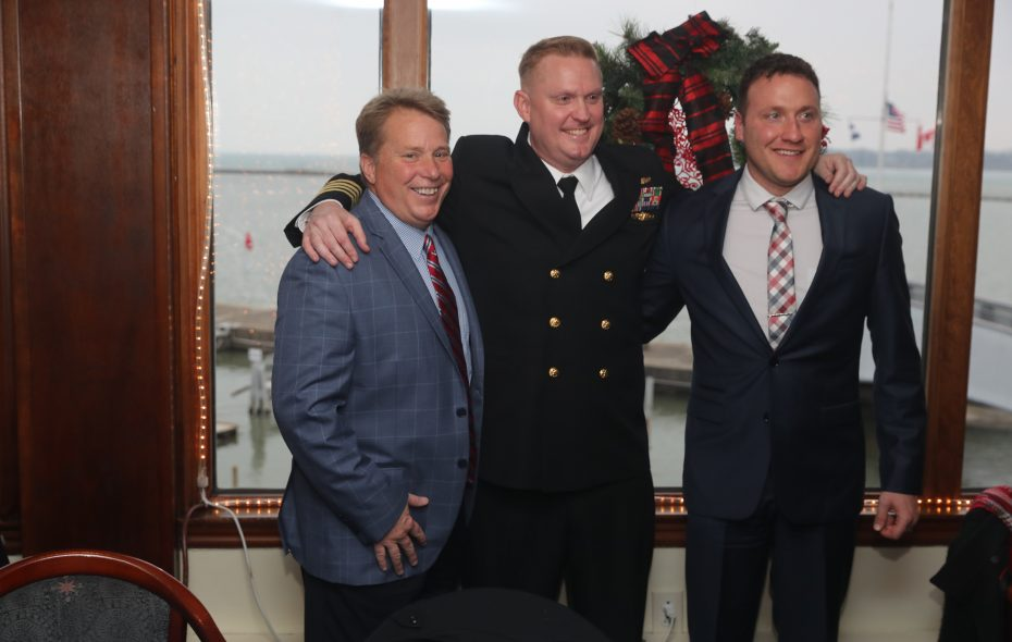 United States Navy Commander Cory Schemm, center, was promoted to captain during a ceremony Saturday at the Buffalo Yacht Club attended by family and friends, including his former high school coach Bob Mullen, left, and Maryvale high school teammate Ryan Mountain. (John Hickey/Buffalo News)