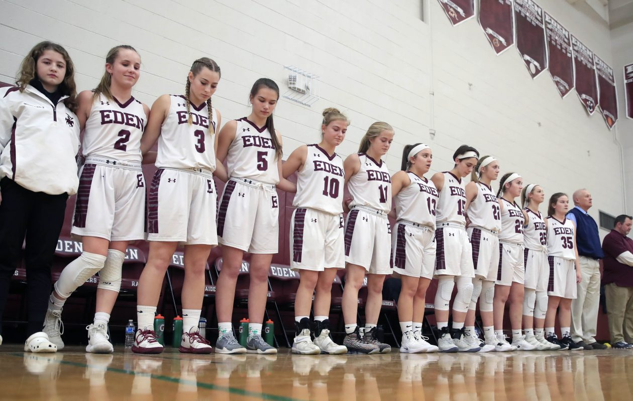 Eden girls basketball team pays tribute to Amy Banks, a guidance counselor who suffered a fatal heart attack over the winter break.  (Harry Scull Jr./ Buffalo News)