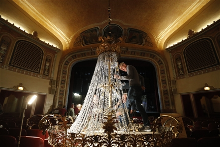 Volunteers spent five days carefully cleaning the 15,000 pieces of crystal and replacing the 140 light bulbs with LED bulbs on the 15-foot-tall chandelier at the Riviera Theatre in North Tonawanda.