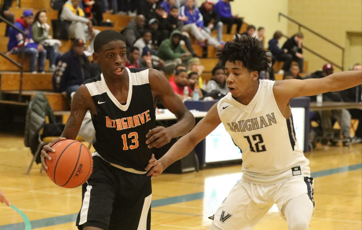 Hargrave Military Academy's Davonte Gaines is fouled by Vaughan Prep's Wazir Latiff in the second quarter of Sunday's game at Villa Maria College. (James P. McCoy/Buffalo News)
