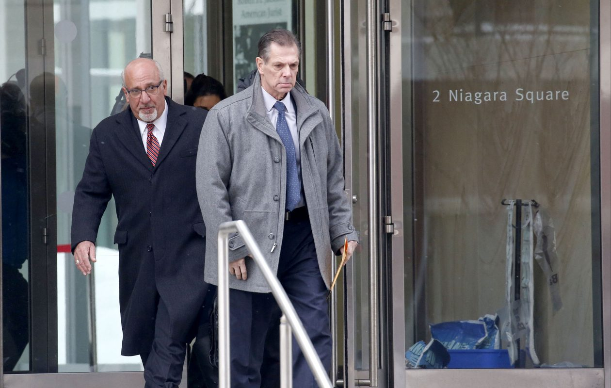 Former Kenmore police chief Peter J. Breitnauer, right,  leaves Robert H. Jackson United State Courthouse near Niagara Square, with his attorney Tom Eoannou after attending to his plea arrangement on Thursday, Jan. 10, 2019.  (Robert Kirkham/Buffalo News)