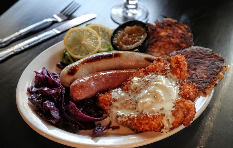 The grilled chicken schnitzel comes with arugula, tomato and goat cheese. (Sharon Cantillon/Buffalo News)