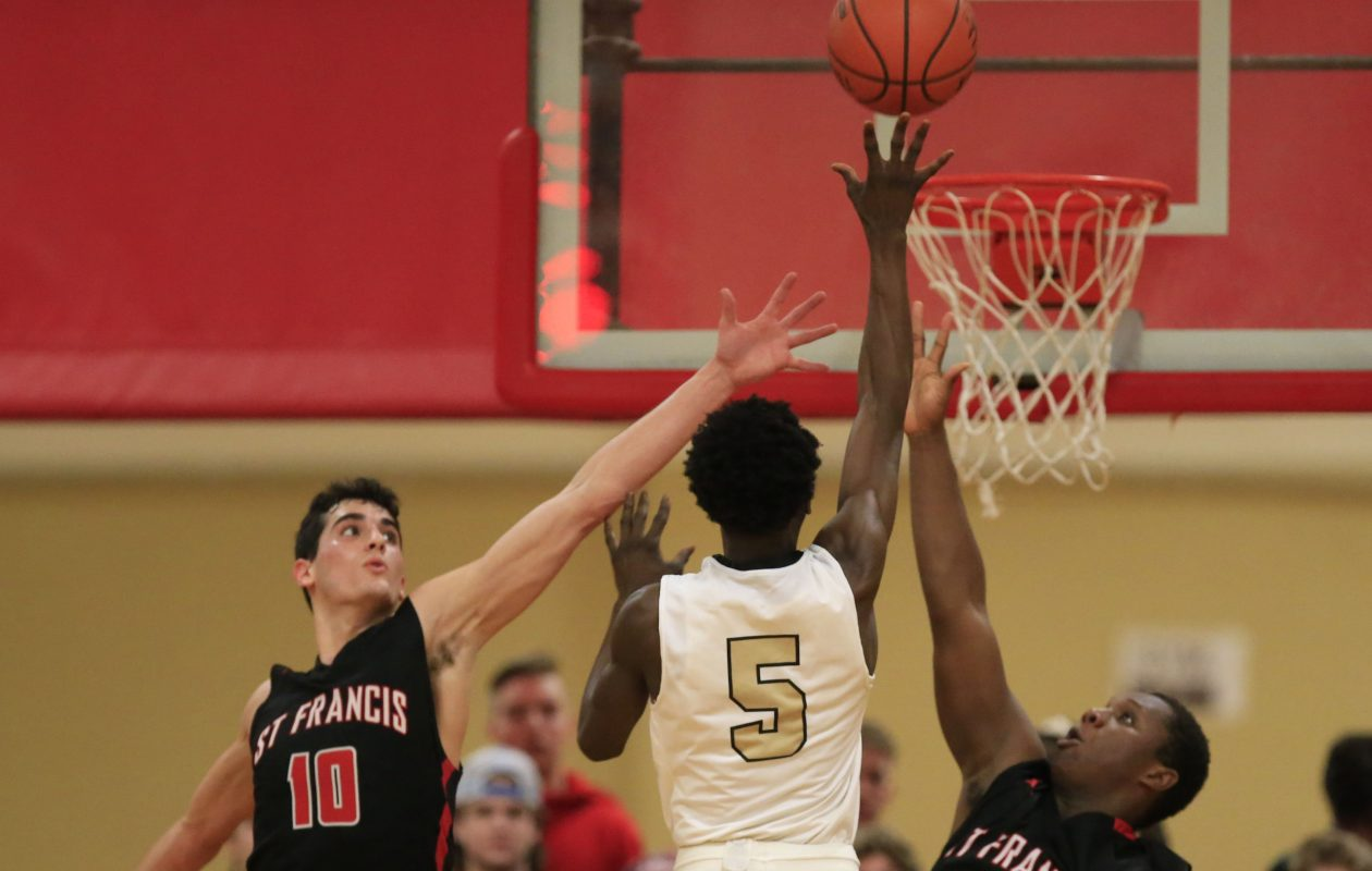Cardinal O'Hara forward Avion Harris shoots over St. Francis defenders Lucas Theisen and Traevone Scott during second half action at St. Francis on Wednesday. (Harry Scull Jr./ Buffalo News)