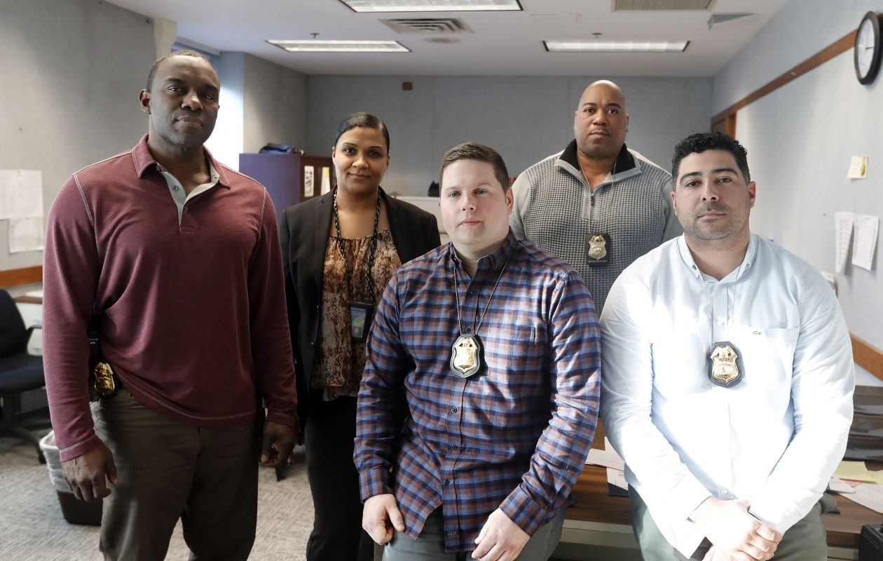 Members of the Buffalo Police Gun Violence Unit, from left: Detective Sgt. Cedric Holloway, Detective Natasha Anderson, Detective Adam Wigdorski, Detective Marlin Hall and Detective Joseph Bonner. (Mark Mulville/Buffalo News)