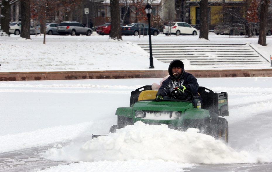 Troy Drake plows the splash pad/ice rink at Martin Luther King Jr. Park on Friday, Jan. 18, 2019. (John Hickey/Buffalo News)