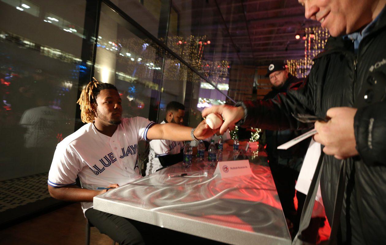 Vladimir Guerrero signs autographs for Bisons fans. (James P.  McCoy/Buffalo News)