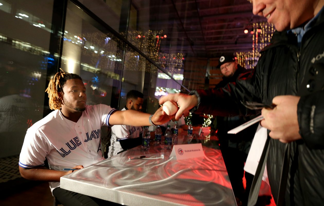 'My mind is on just doing a good job, staying focused and doing the best that I can like last year,' said 19-year-old Vladimir Guerrero Jr. through an interpreter Thursday night as he signed autographs at the Bisons' Hot Stove Prospect Showcase in The Atrium at Rich's. (James P. McCoy/Buffalo News)
