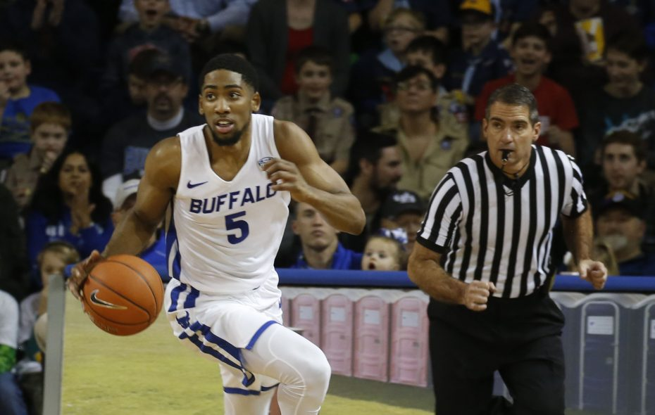 UB's CJ Massinburg (5) scored 23 points Tuesday in a 77-75 loss at Northern Illinois. (Robert Kirkham/News file photo)