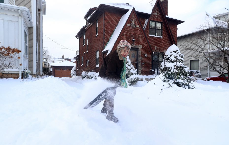 Kim Van Dyke shovels her  driveway on Niagara Falls Boulevard in Buffalo on Sunday afternoon. (John Hickey/Buffalo News)