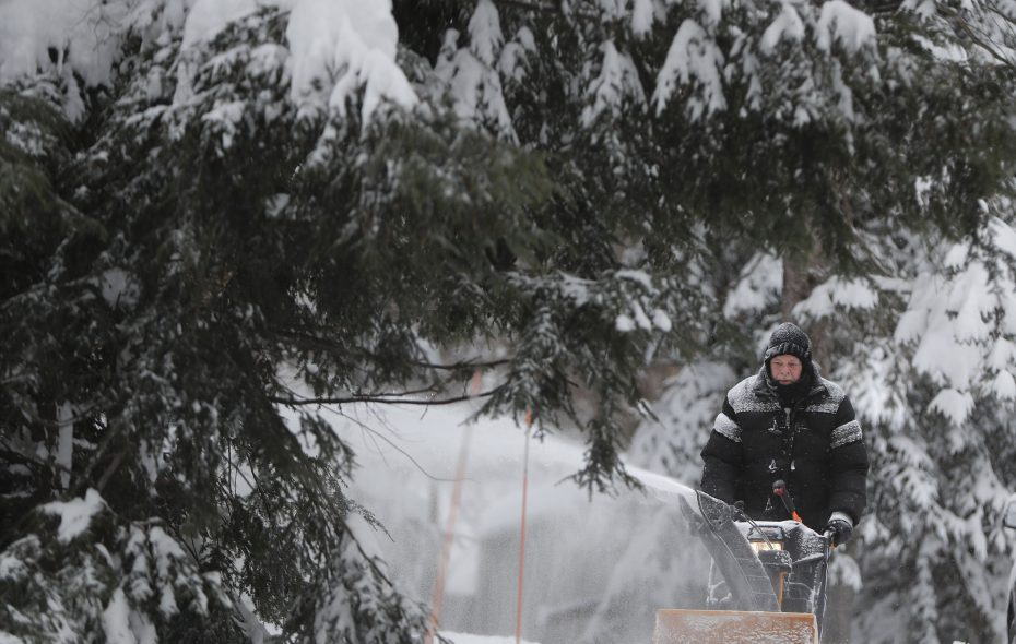 Jerry Morrison clears the snow from his driveway in Orchard Park on Sunday. (Mark Mulville/Buffalo News)