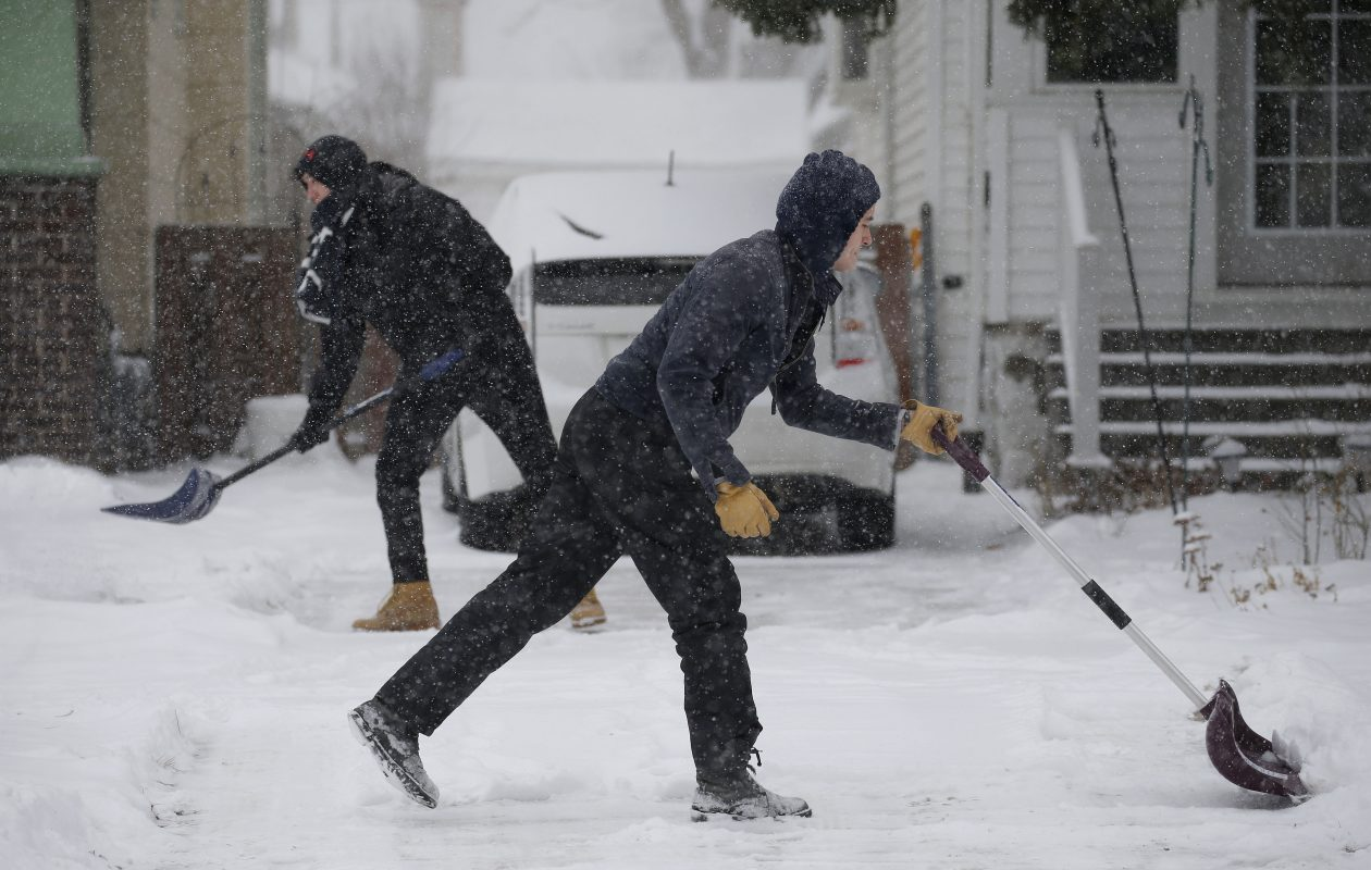 Brandon Lema, right, and his brother Joey Lema, left, shovel their driveway on Mckinley Pkwy in Buffalo Saturday, January 19, 2019.      (Mark Mulville/Buffalo News)