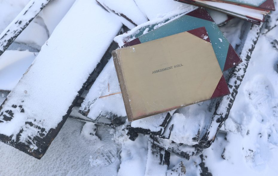 An old book of assessment rolls remained unscathed in the fire that burned down Barker's Village Hall and library. (John Hickey/Buffalo News)