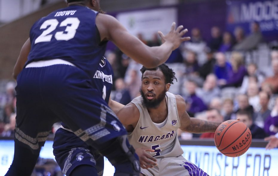 Niagara University guard James Towns dribbles against St. Peters during the first half of a college basketball game at the Gallagher Center on Tuesday, Jan. 22, 2019. (Harry Scull Jr./ Buffalo News)