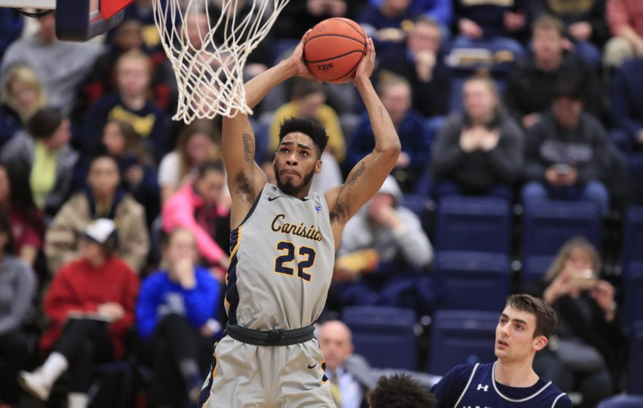 Canisius forward Jibreel Faulkner goes in for a dunk against Monmouth in the first half Thursday (Harry Scull Jr./Buffalo News)