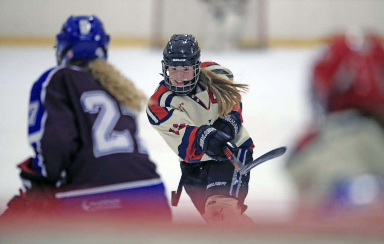 Williamsville center Emma Roland shoots against Frontier/Lake Shore/Orchard Park during a recent Federation girls hockey contest. (Harry Scull Jr./Buffalo News)