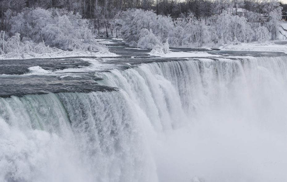 Ice from the mist coats everything surrounding Niagara Falls at Prospect Point in Niagara Falls State Park, Tuesday, Jan. 22, 2019. (Derek Gee/Buffalo News)