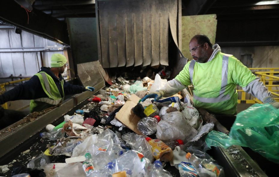Oli Ullah, left, and Rafi Bin Isak do sorting on the presort line. They take out trash and oversized plastic and metal recyclables at Buffalo Recycling Enterprise, 266 Hopkins St. (Sharon Cantillon/Buffalo News)