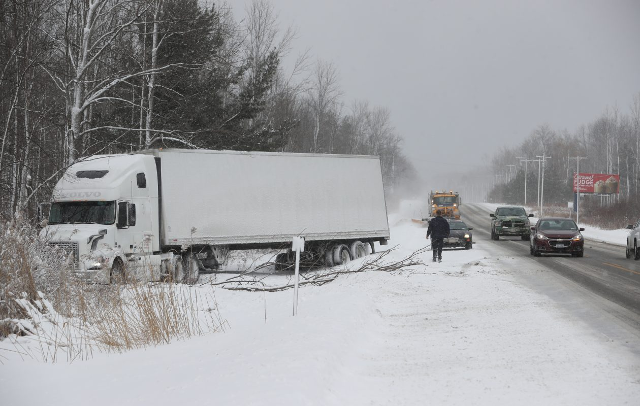 A tractor-trailer off the road on Route 20 near Gowan Road in Angola on Friday, Jan. 25, 2019. (John Hickey/Buffalo News)