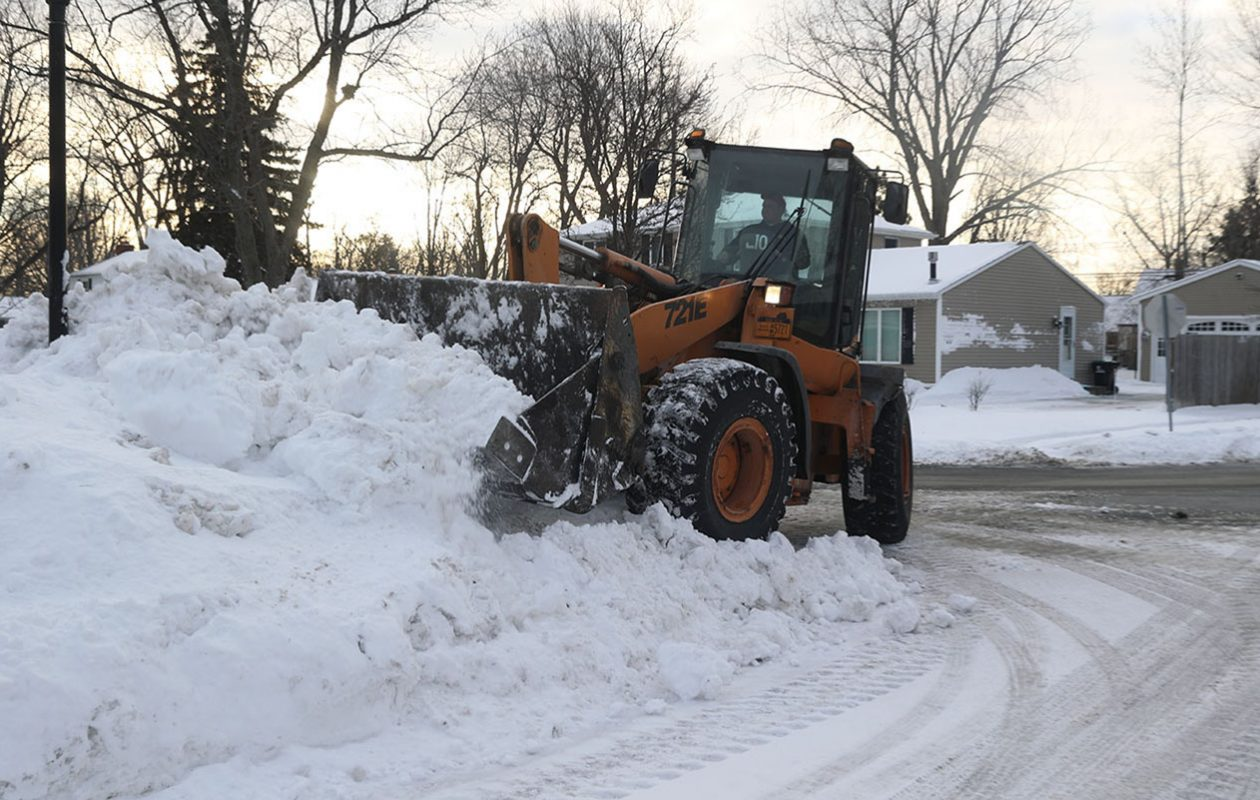 A Town of Tonawanda Highway crew removes snow from Sweet Briar Court in the Town of Tonawanda on Jan. 28. (John Hickey/Buffalo News)