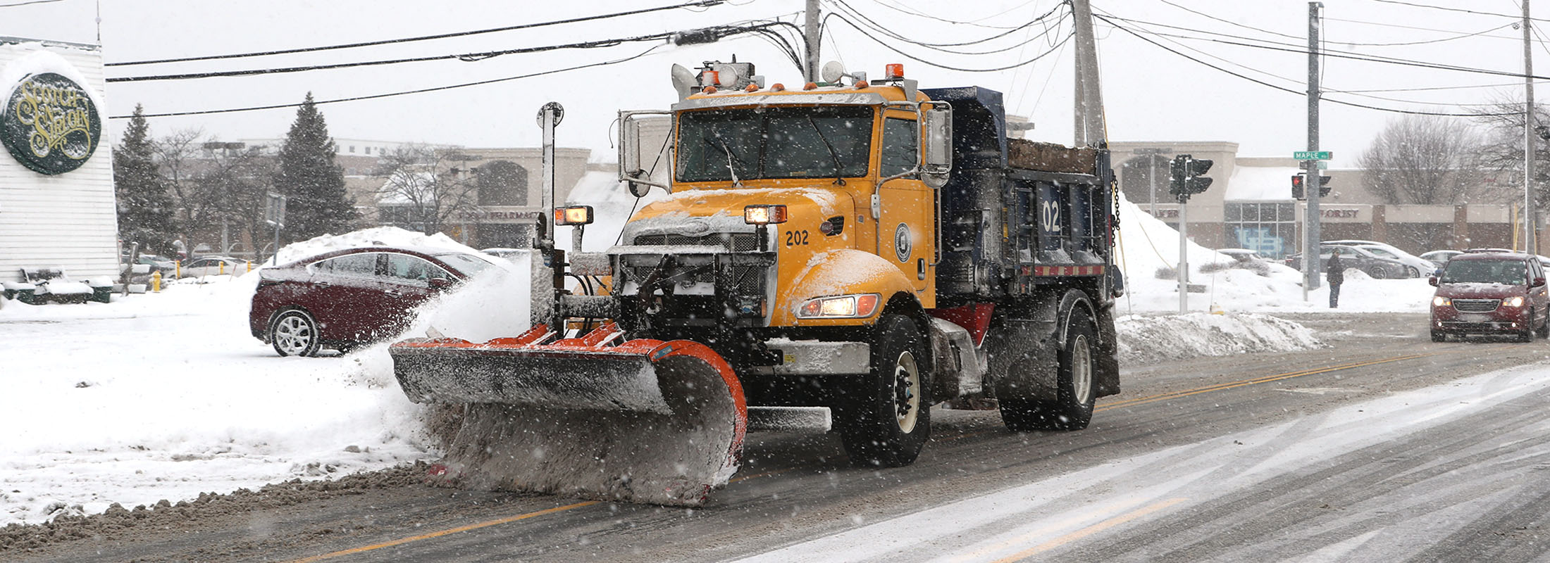 A town plow clears Bailey Avenue,in Amherst on Jan. 29. (John Hickey/Buffalo News)