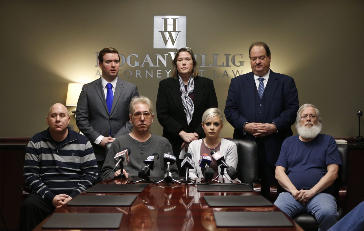 Standing from left, attorneys William Lorenz Jr., Diane Tiveron and Steven Cohen, hold a press conference with victims of Catholic sex abuse, seated from left, Kevin Haslam, Antonio 'Tino' Flores, Vanessa DeRosa and Michael Eames, to discuss the passage of the Child Victims Act. (Derek Gee/Buffalo News)