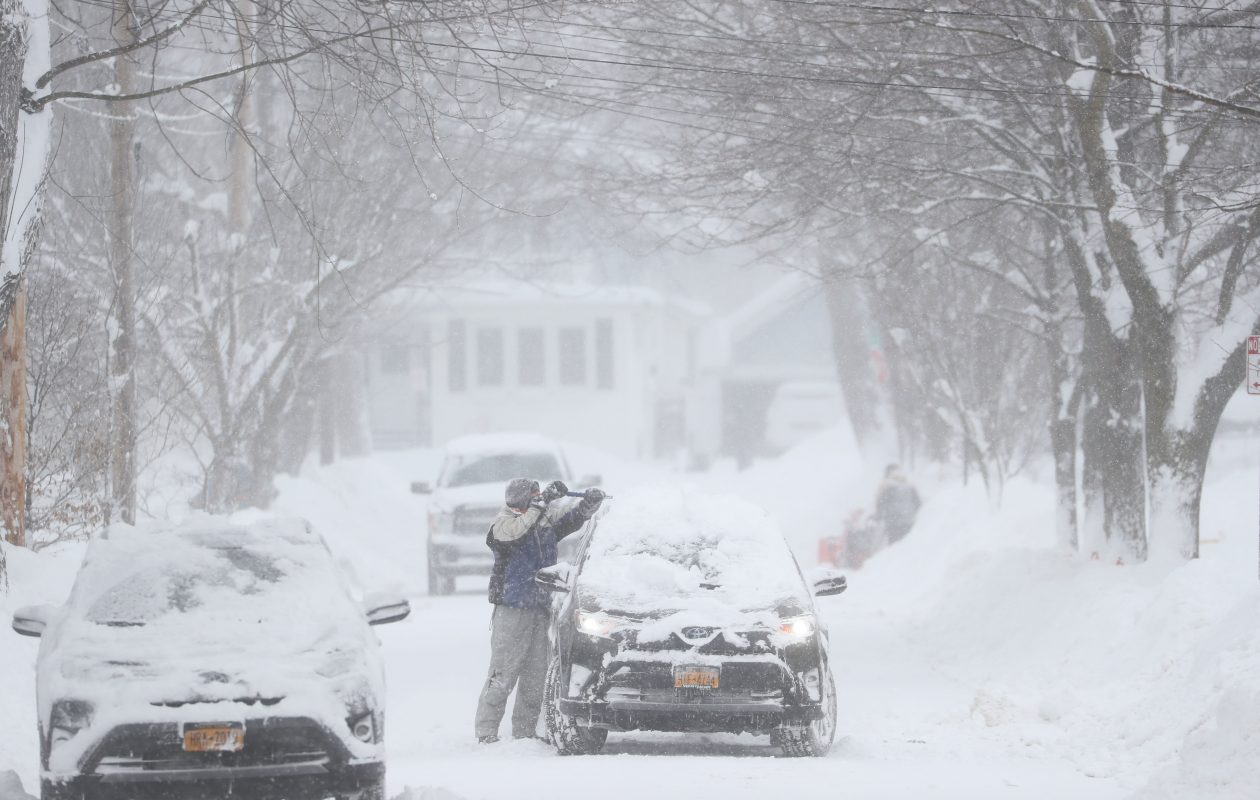 Jim Nau cleans off his car and driveway on Los Robles in Williamsville, Wednesday, Jan. 30, 2019. (Sharon Cantillon/Buffalo News)