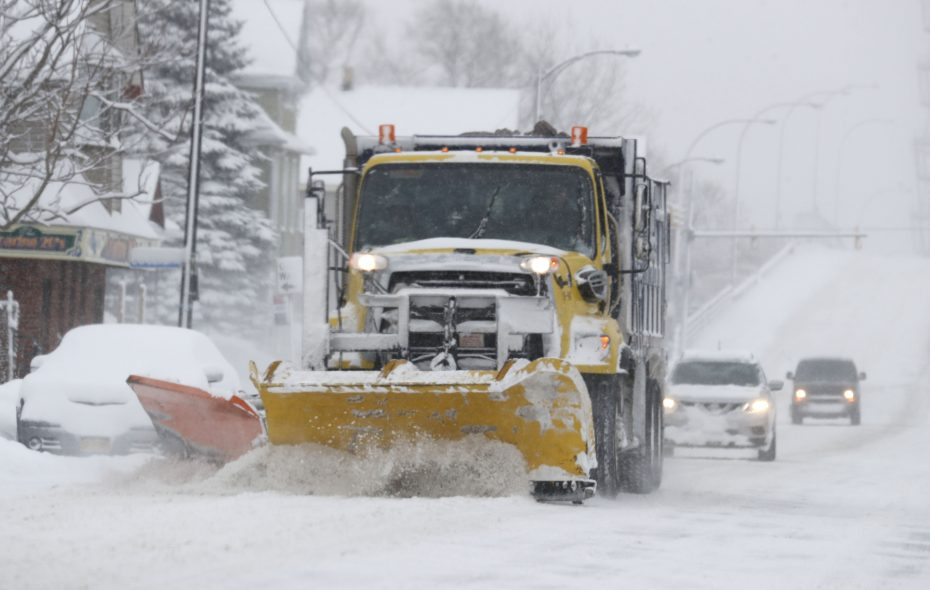 Crews clear South Park Avenue in Buffalo Wednesday morning and will work throughout the night clearing other city streets. (Mark Mullville/Buffalo News)