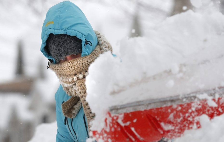 Ashley Frey shovels her driveway on Sheffield Avenue in Buffalo amid a storm that became categorized as a blizzard at the end of January. (Mark Mulville/Buffalo News)