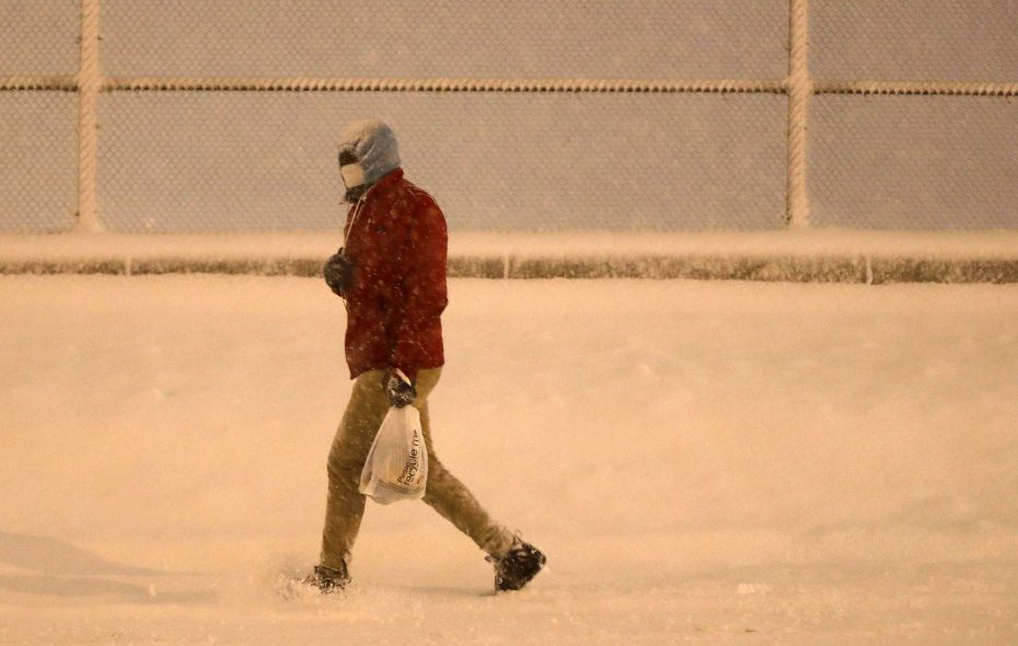A pedestrian walks down Michigan Avenue in the cold temperatures on Wednesday. (Mark Mulville/Buffalo News)