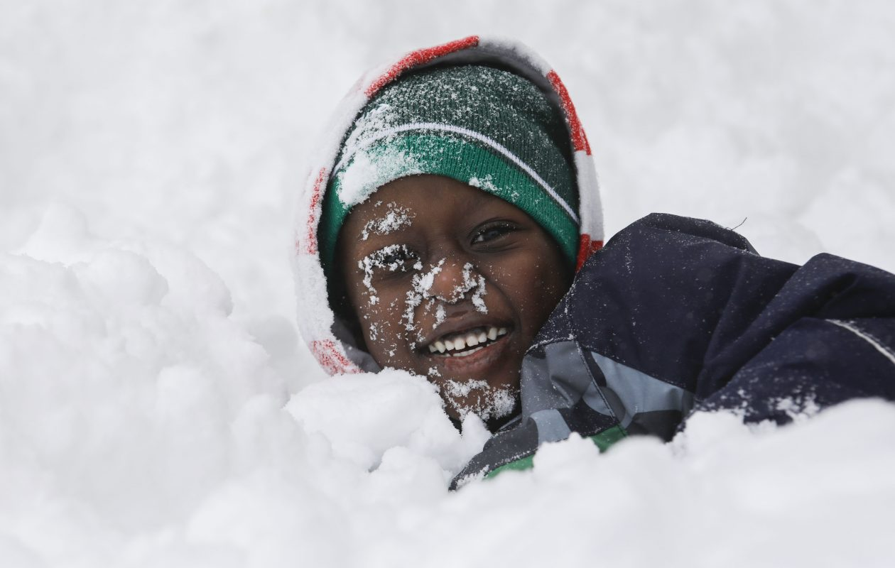 Hamdan Elmouss, 4, plays in a pile of snow in front of his home on Prospect Avenue on Wednesday, Jan. 30, 2019.   (Derek Gee/Buffalo News)
