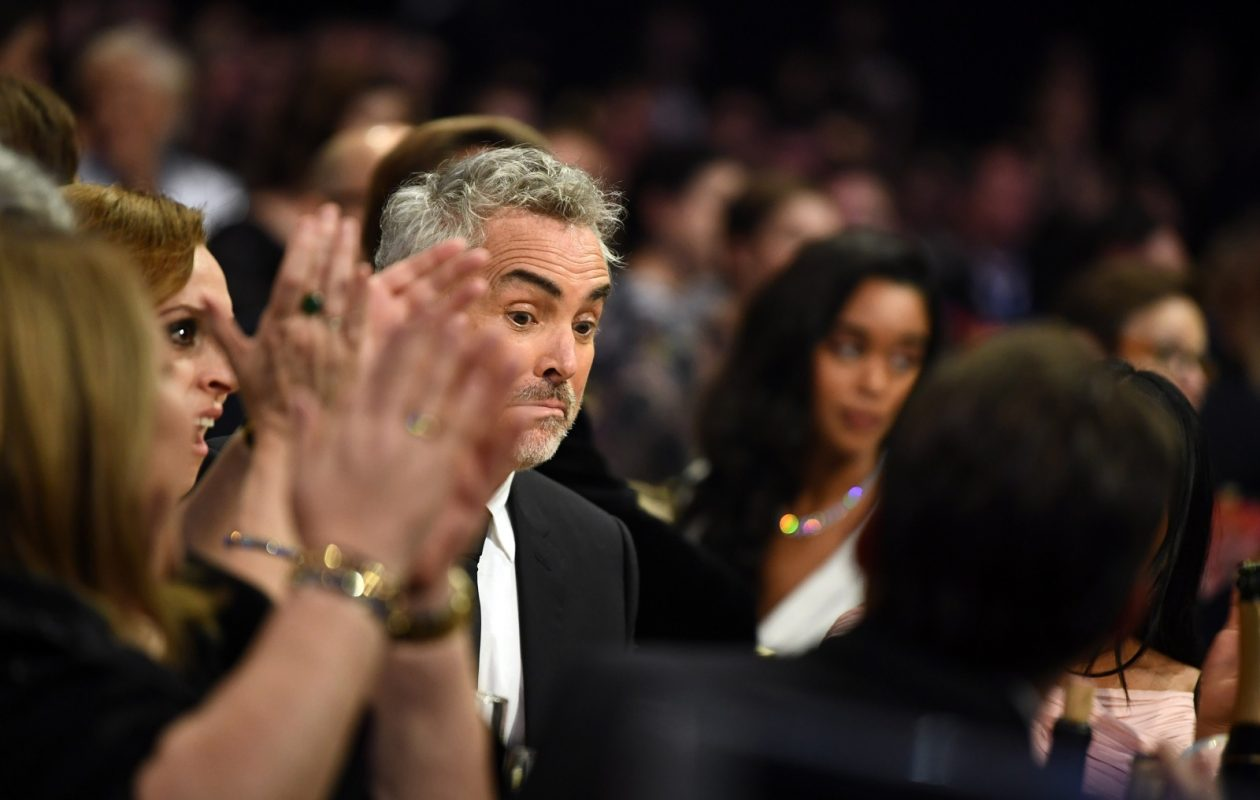 Alfonso Cuaron walks onstage Sunday to accept the best director award for 'Roma' at the 24th annual Critics' Choice Awards at Barker Hangar in Santa Monica, Calif. (Emma McIntyre/Getty Images for the Critics' Choice Awards)